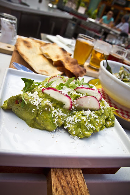 Guacamole - Chef's handmade recipe with avocados, lime, chile, Cotija cheese, served with crisp olive oil brushed flatbread